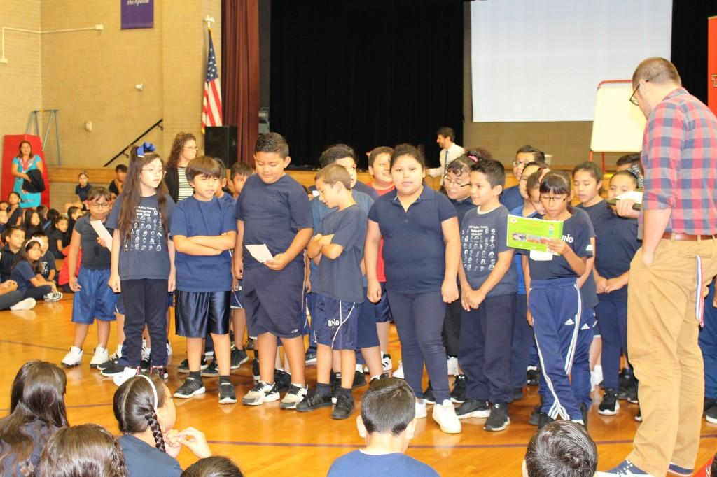 Third grade students doing their classroom cheer