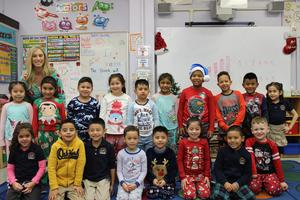 3rd Grade class in their pj's with their teacher and aide