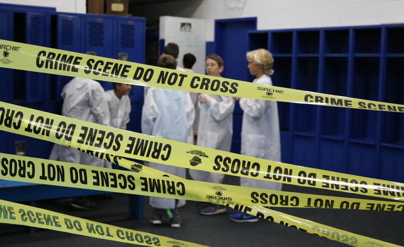 CSI sleuths examine clues during STEM Camp.