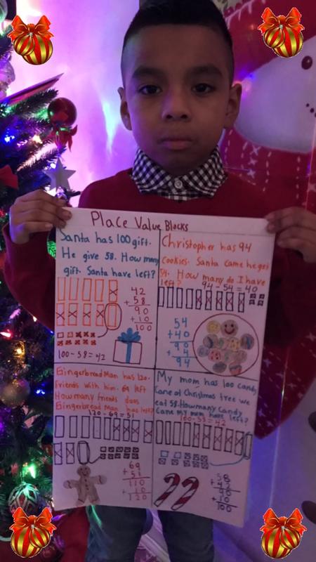 Boy holding math work