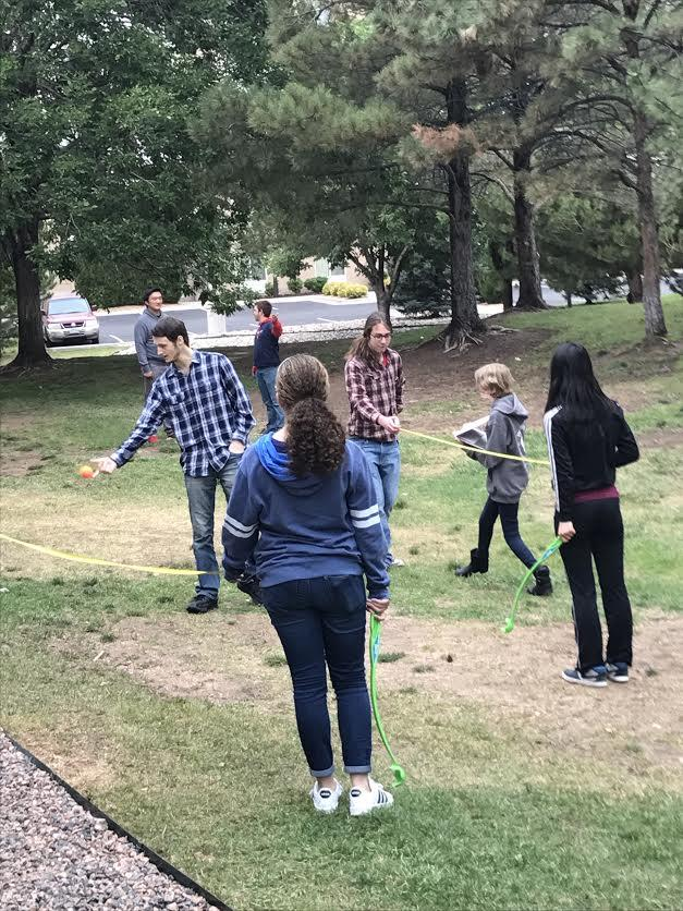 Archaeology students use physics to record the throws of their mock atlatls, an ancient spear-throwing device.