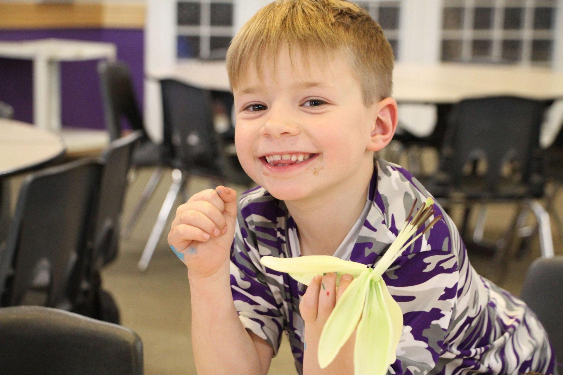Boy holding lilly