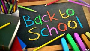 chalkboard with colorful chalk and the words back to school
