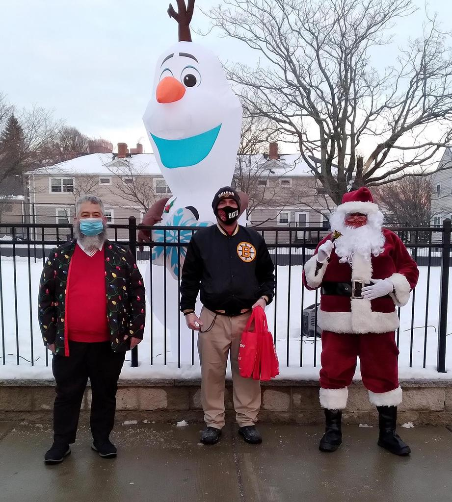 Three adults, one dressed as Santa Claus