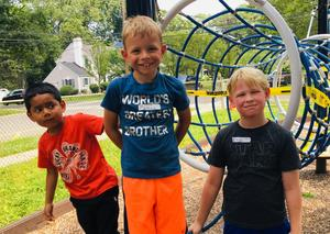 L-R McKinley 1st graders Yazid Merino and Mathew Perlak with 3rd grader Nikolai Filippov enjoy some playground time during the English Language Learners (ELL) Summer Experience.