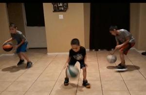 brothers dribbling basketball together