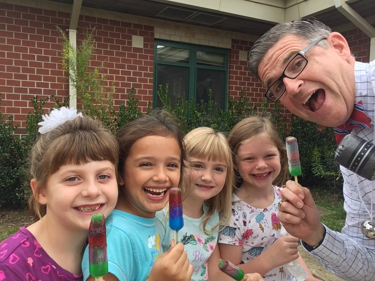 mr. brennan with students eating popsicles