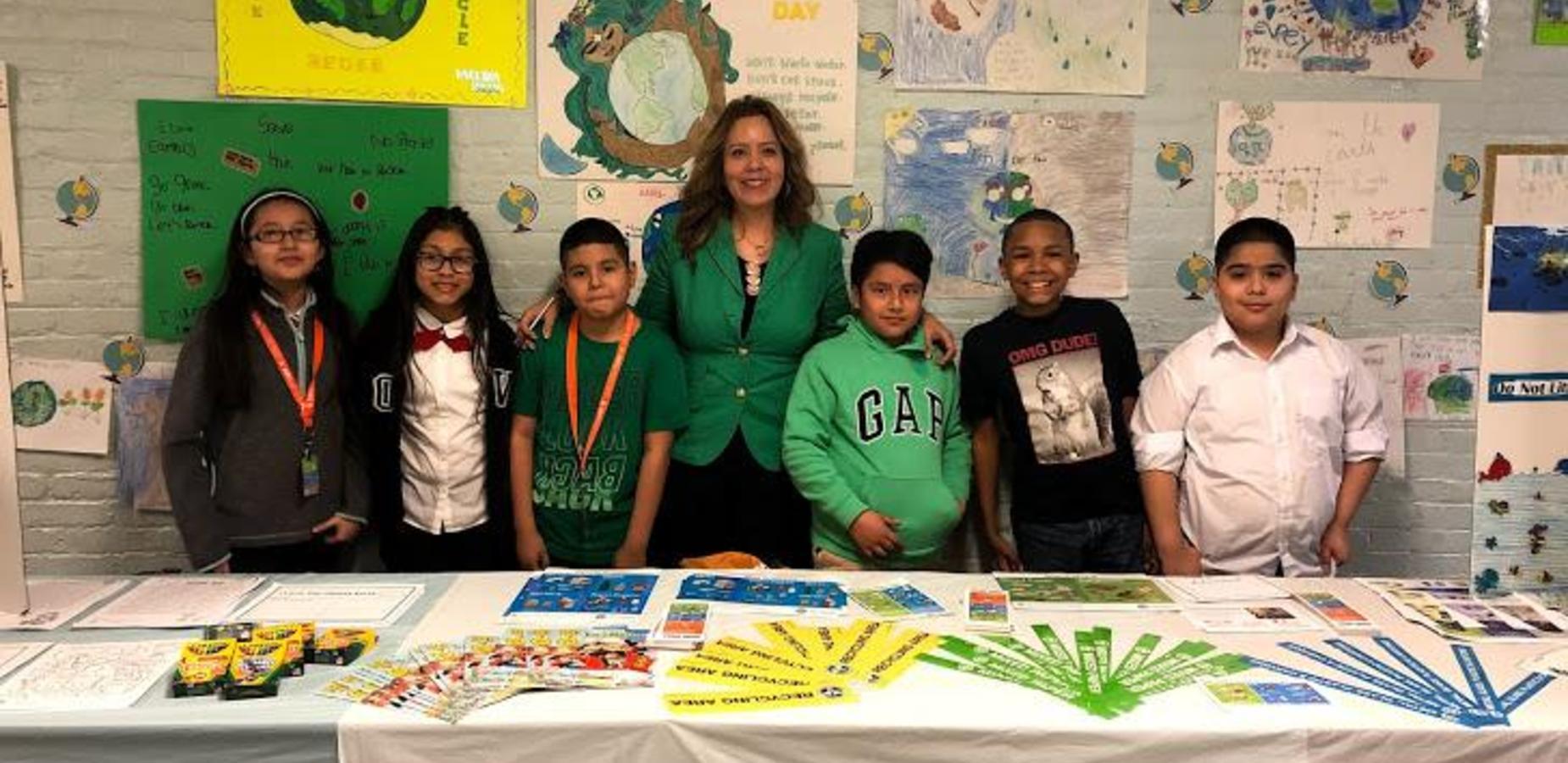 Principal Garzon & Green Team member at Earth Day Celebration.