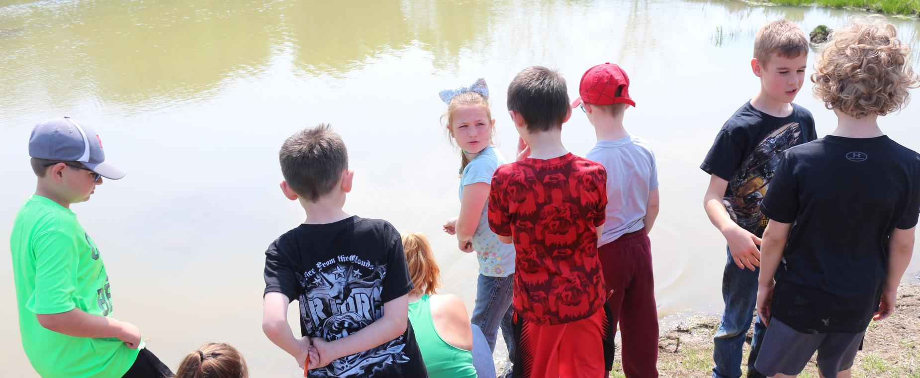 Students learning about biodiversity at Muddy Paws Marsh