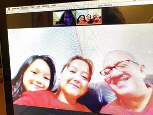 Parents with student smiling on zoom