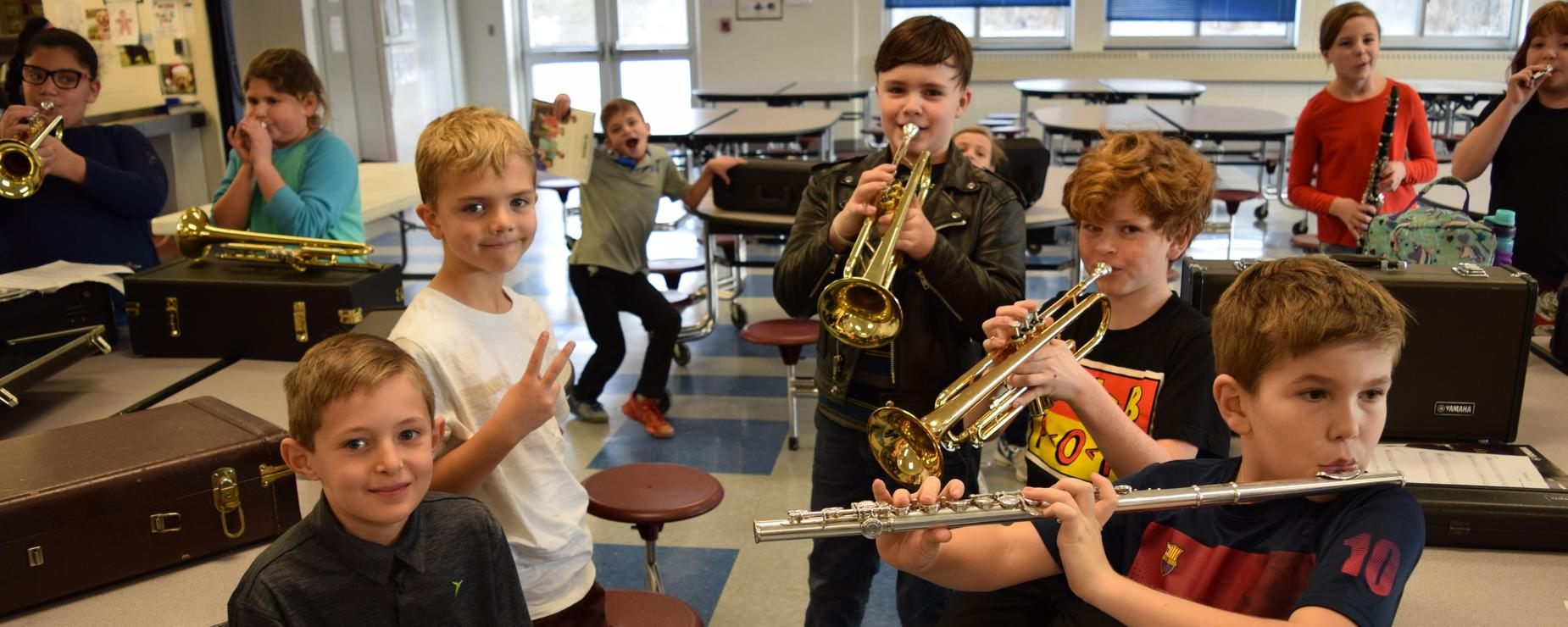 Students warming up their musical instruments