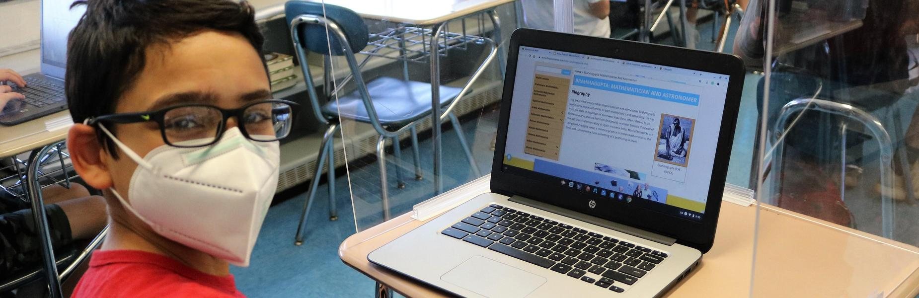 Photo of Edison student with laptop on Cultural Diversity Day