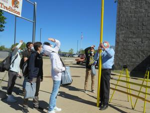 Kirk Mulder with Hastings Fiber Glass Products, extends one of the poles showing students how they help the electrical power and communications industries.