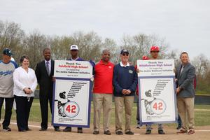 Photo of representatives from Middletown High School, the Joe Nuxhall Character Education Fund and the Cincinnati Reds Community Fund, the Fairfield High School baseball team representative and superintendents from Fairfield and Middletown city schools.