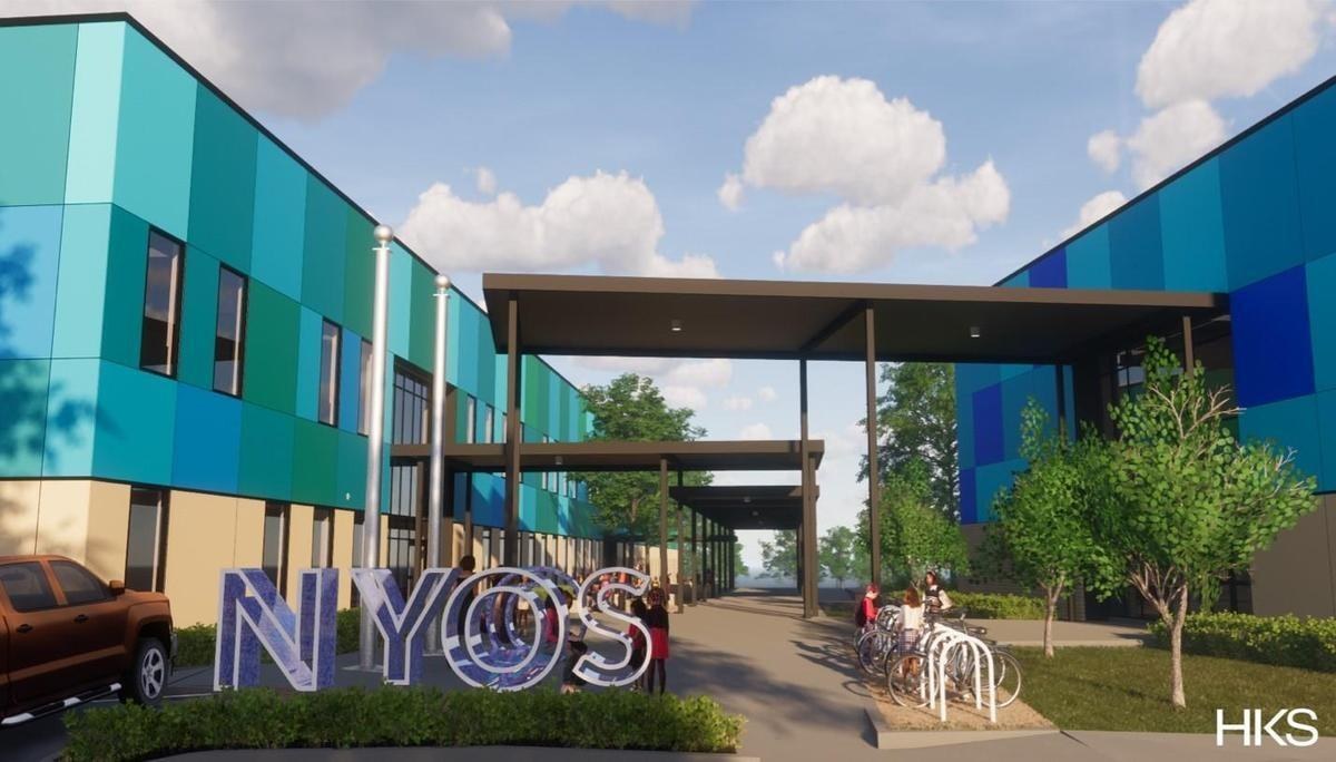 "Rendering of new campus facility. Two buildings that are beige, blue, and teal are connected with a walkway and a sign is in front of these buildings that says ""NYOS."""