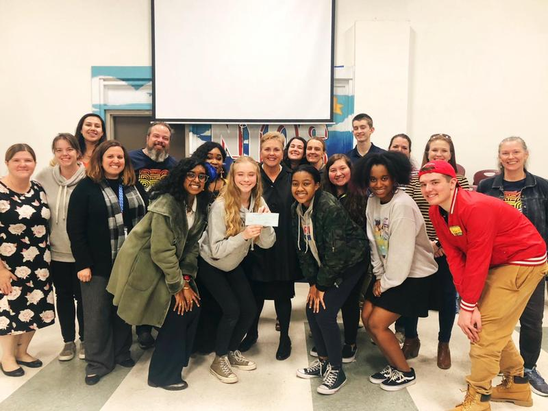 Photo of NYOS TAFE high school students, PTA Board members, and NYOS staff with check awards to TAFE during the General PTA Meeting.