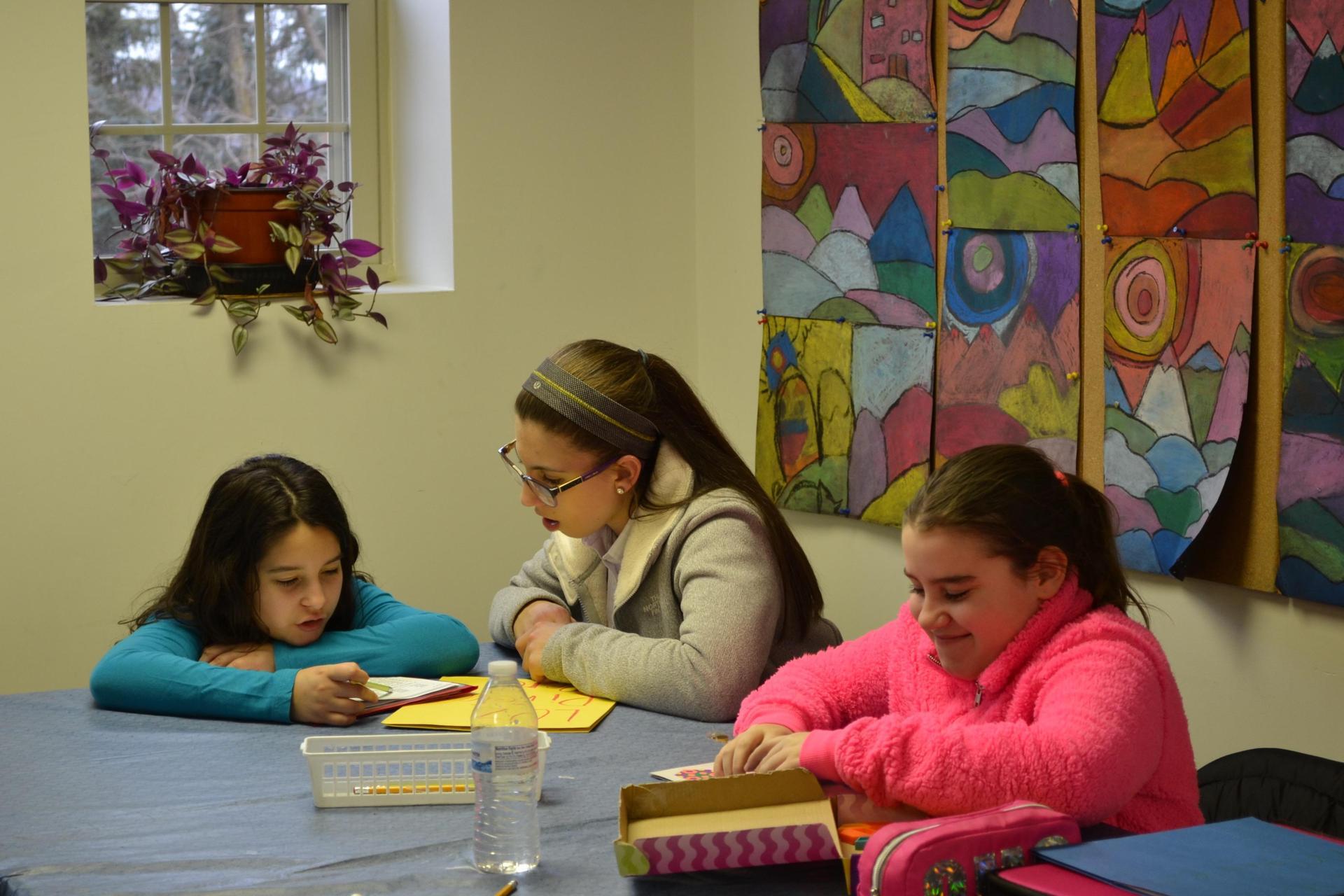 Francesca tutoring children at the Mooncrest After School Program.