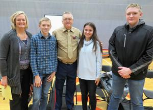 Honored veteran Ivan Ploeg is pictured with his three grandchildren who all attend TK, and his daughter.