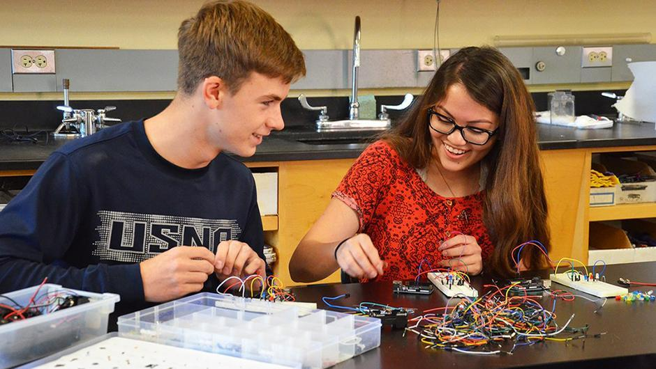 Upper school students working on circuitry