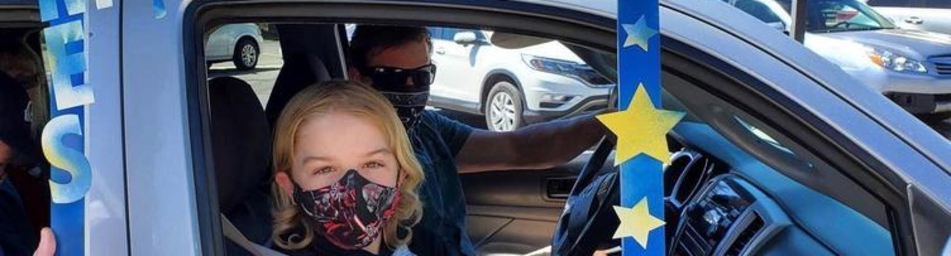 Student inside a car