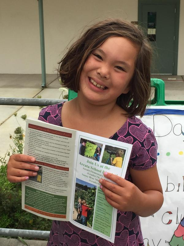 Smiling girl with activities catalogue