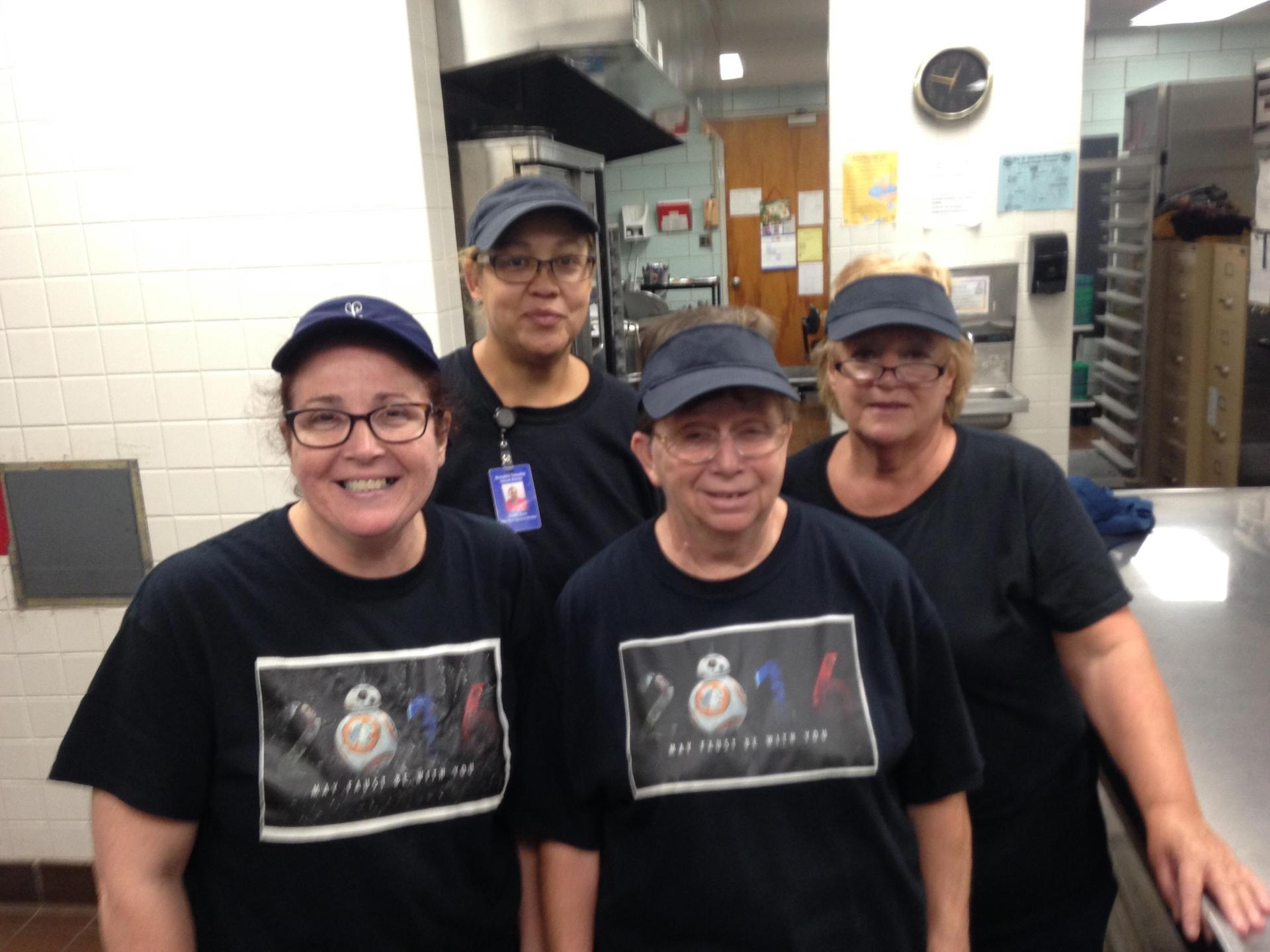 Faust Cafeteria staff helps Kindergarten students learn colors, by wearing specific colored shirts each day, pictured are black shirts.