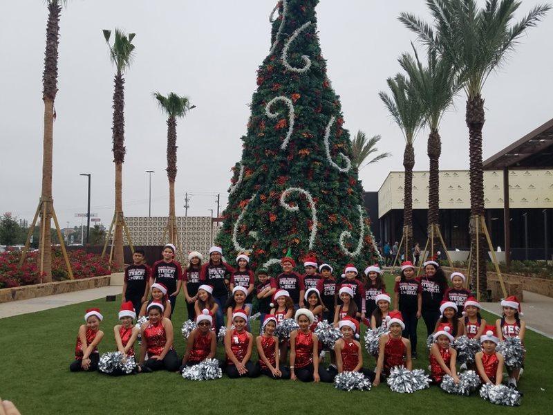 cheerleaders in christmas tree.