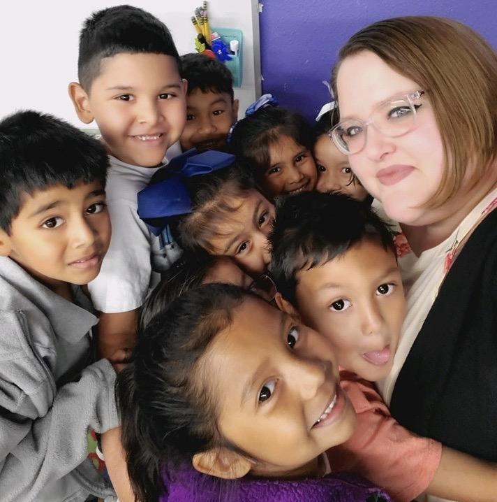 Teacher with kids hugging