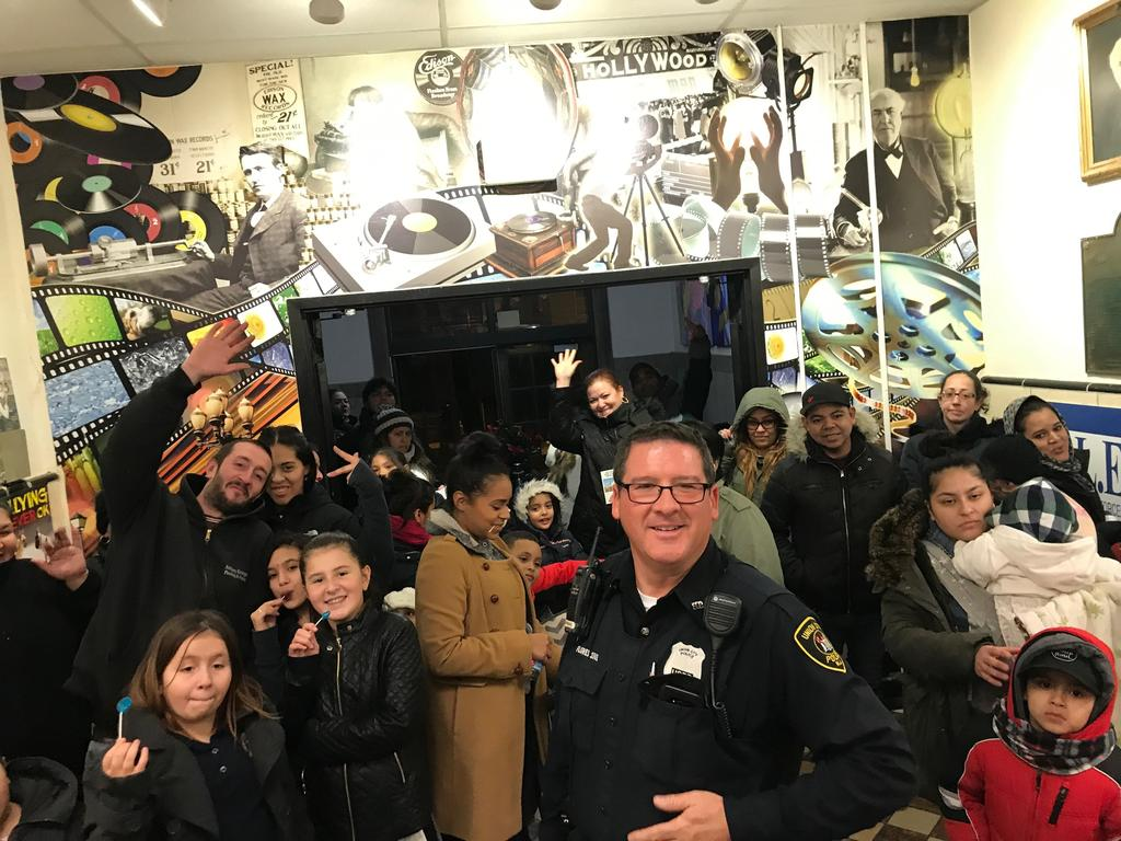 UC PO Flores with the parents and children entering Edison school