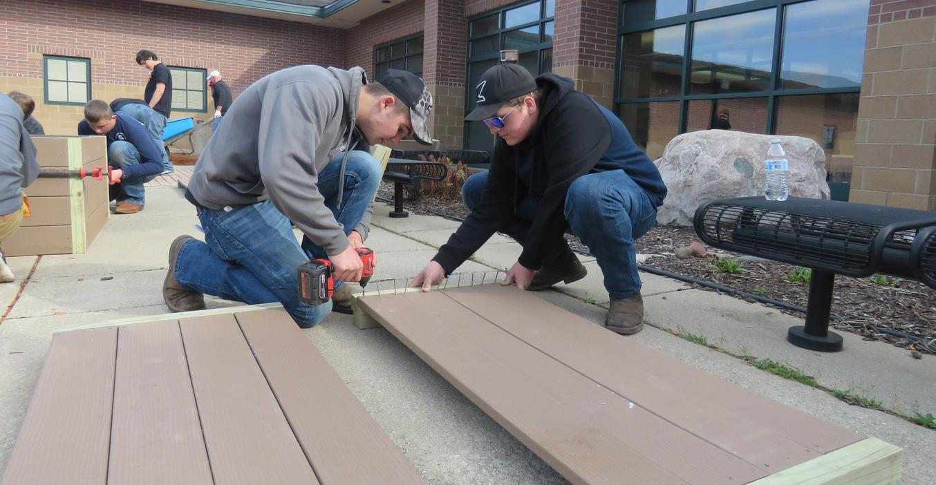 TKHS woods students put together raised garden boxes for the middle school garden.