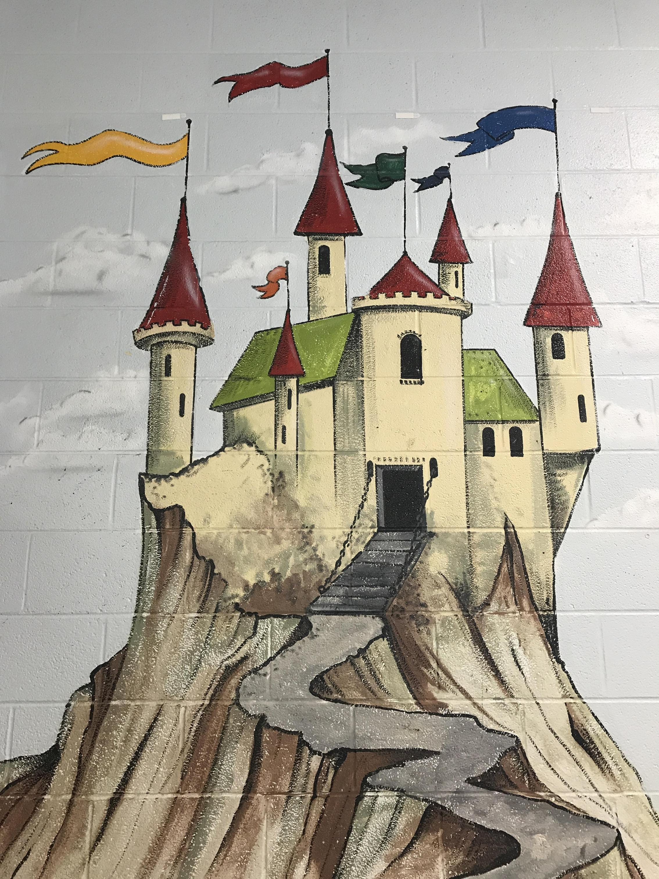 Mural of castle on wall