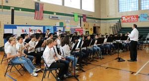 The Edison 8th Grade Band performs patriotic tunes at the school's annual Veterans Day assembly.
