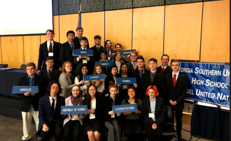 Greenbrier HIgh School Model UN team members pose for photo in courtroom after competition