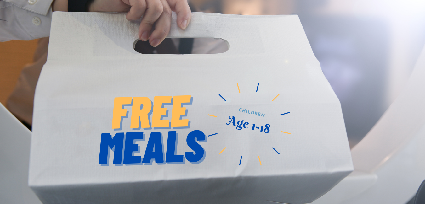 white lunch bag with FREE MEALS written on bag