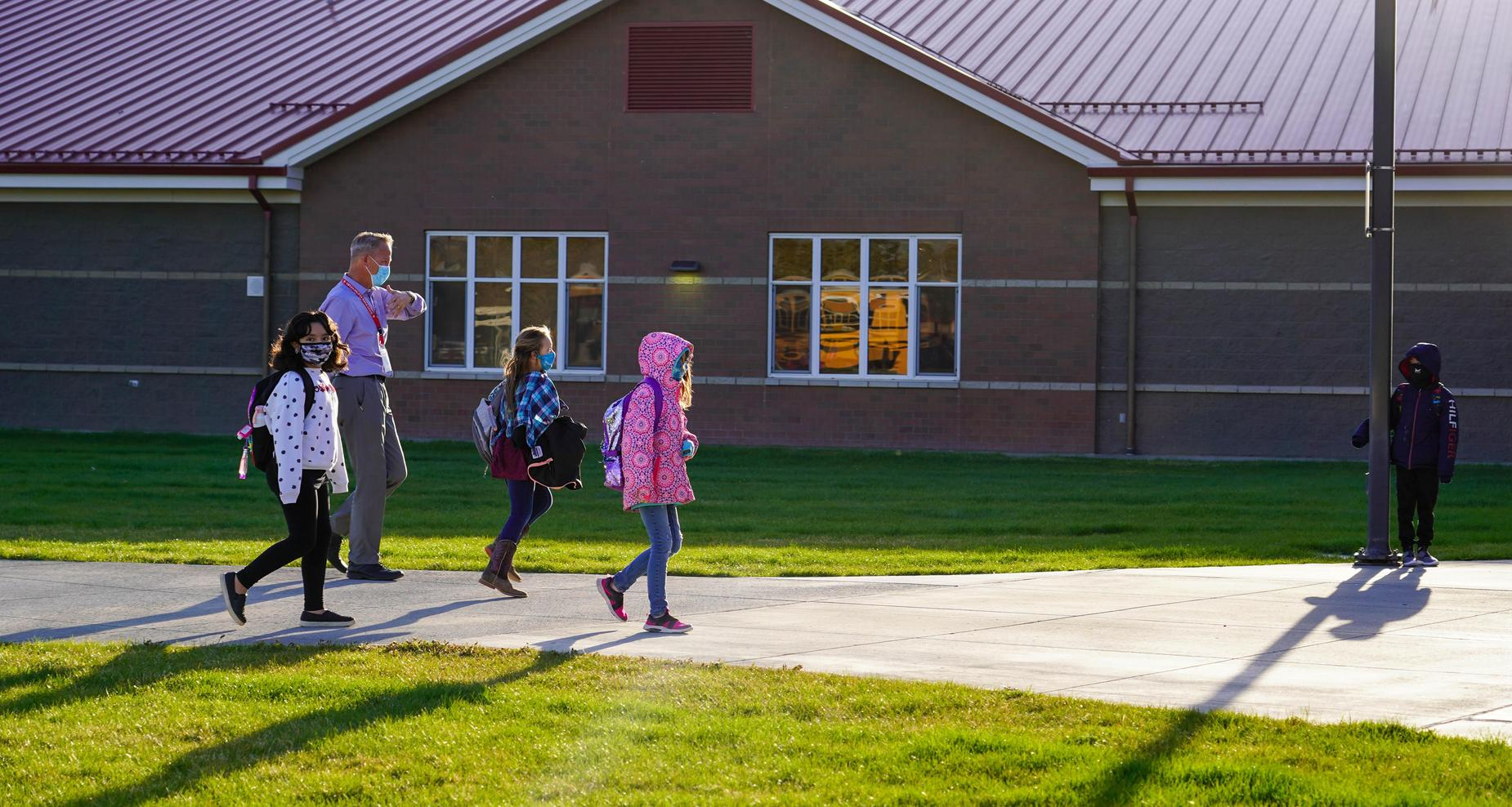 West Park principal walking with students.