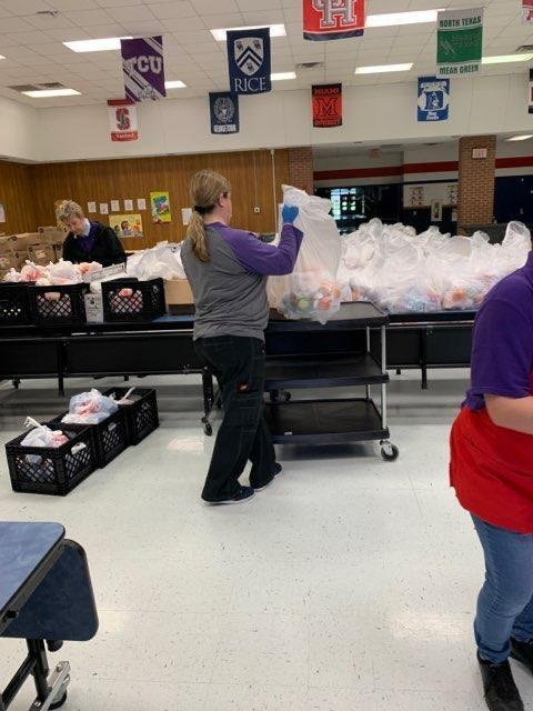 lunch ladies packing up meals