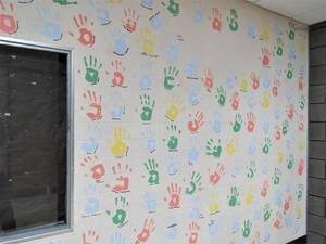 Senior handprints cover the wall near the cafeteria.