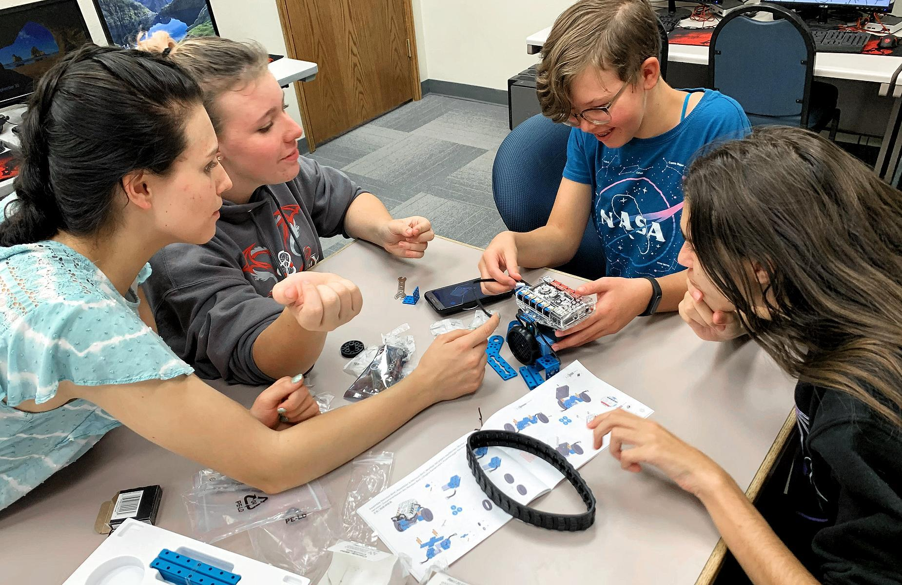 Students building robot