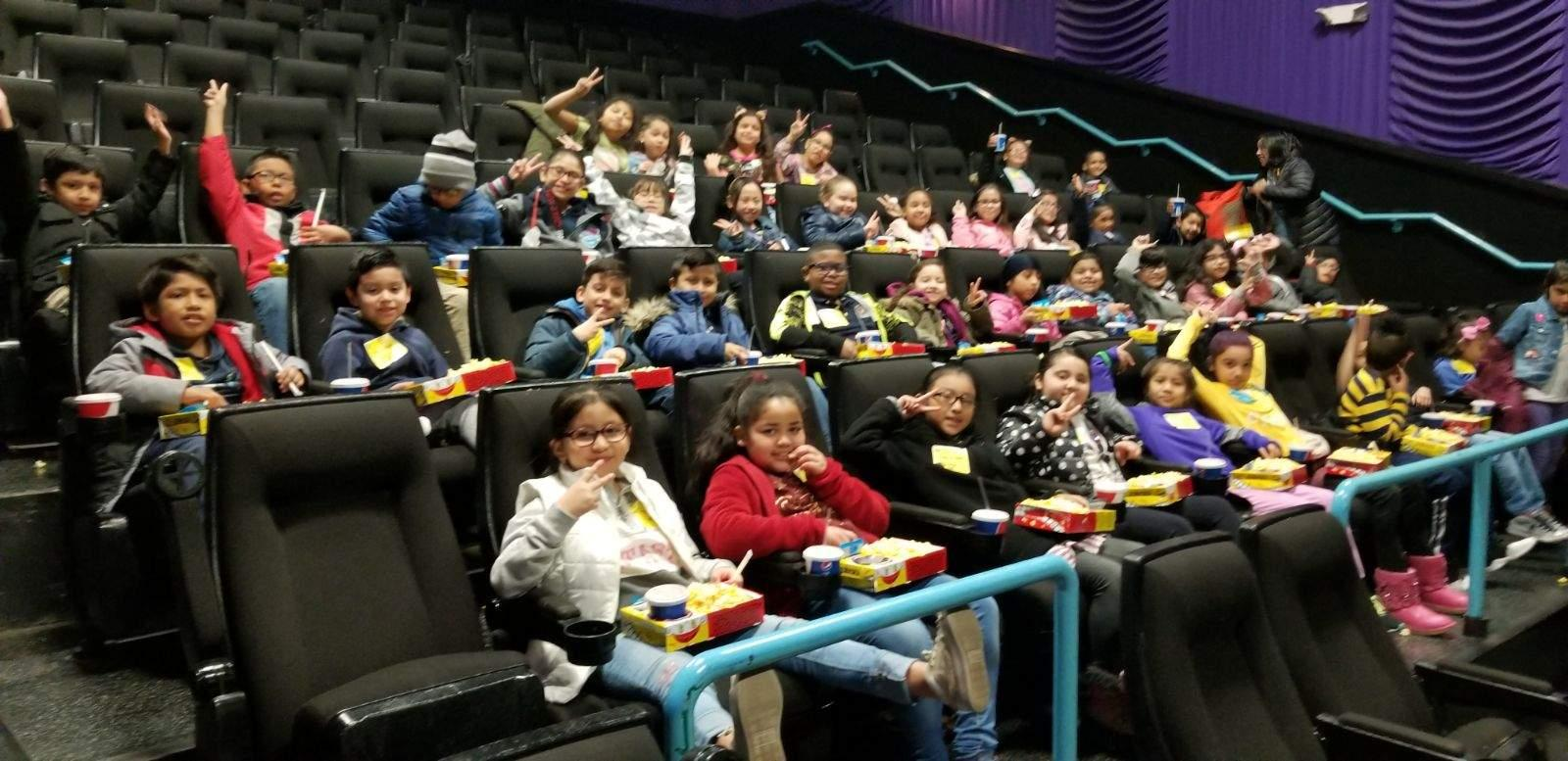 kids waiting for movie to start
