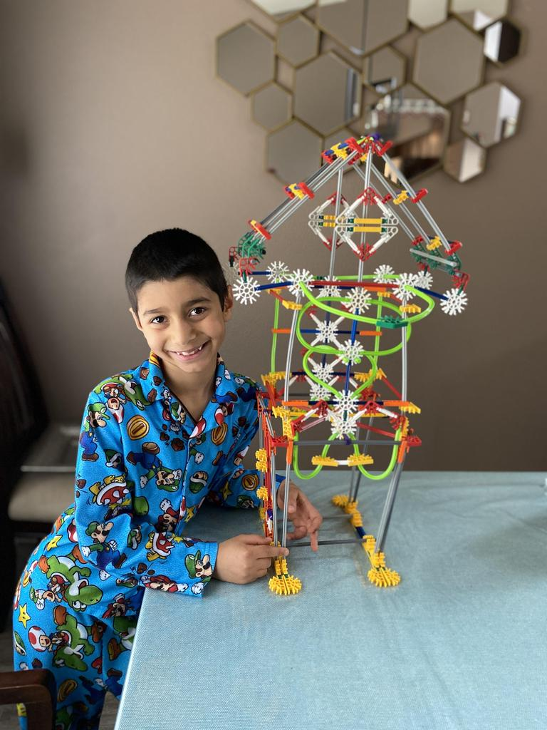 structure on stilts with boy in front