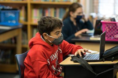 St. Timothy's School fifth grade using laptop in class
