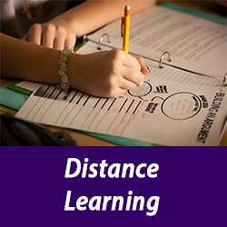 image of student hand working on school work with text Distance Learning