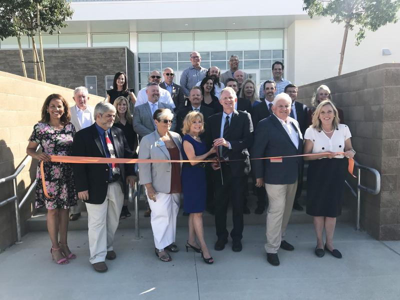 Image of Superintendent Vicki Engbrecht, governing board members, community leaders, district and school administrators taking part in the ribbon-cutting ceremony opening Castaic High School