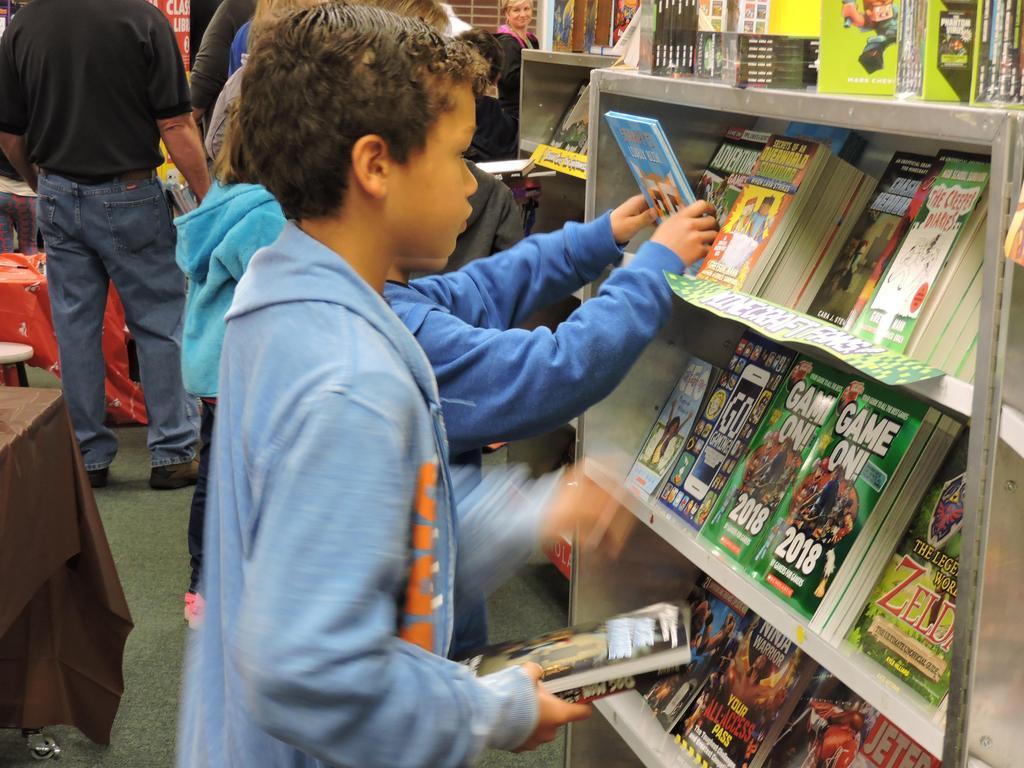 Students shopping at book fair