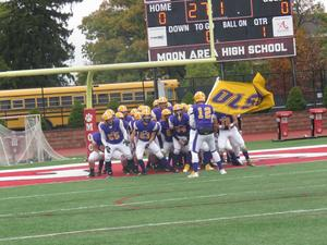 The OLSH Chargers football team prepares to take the field