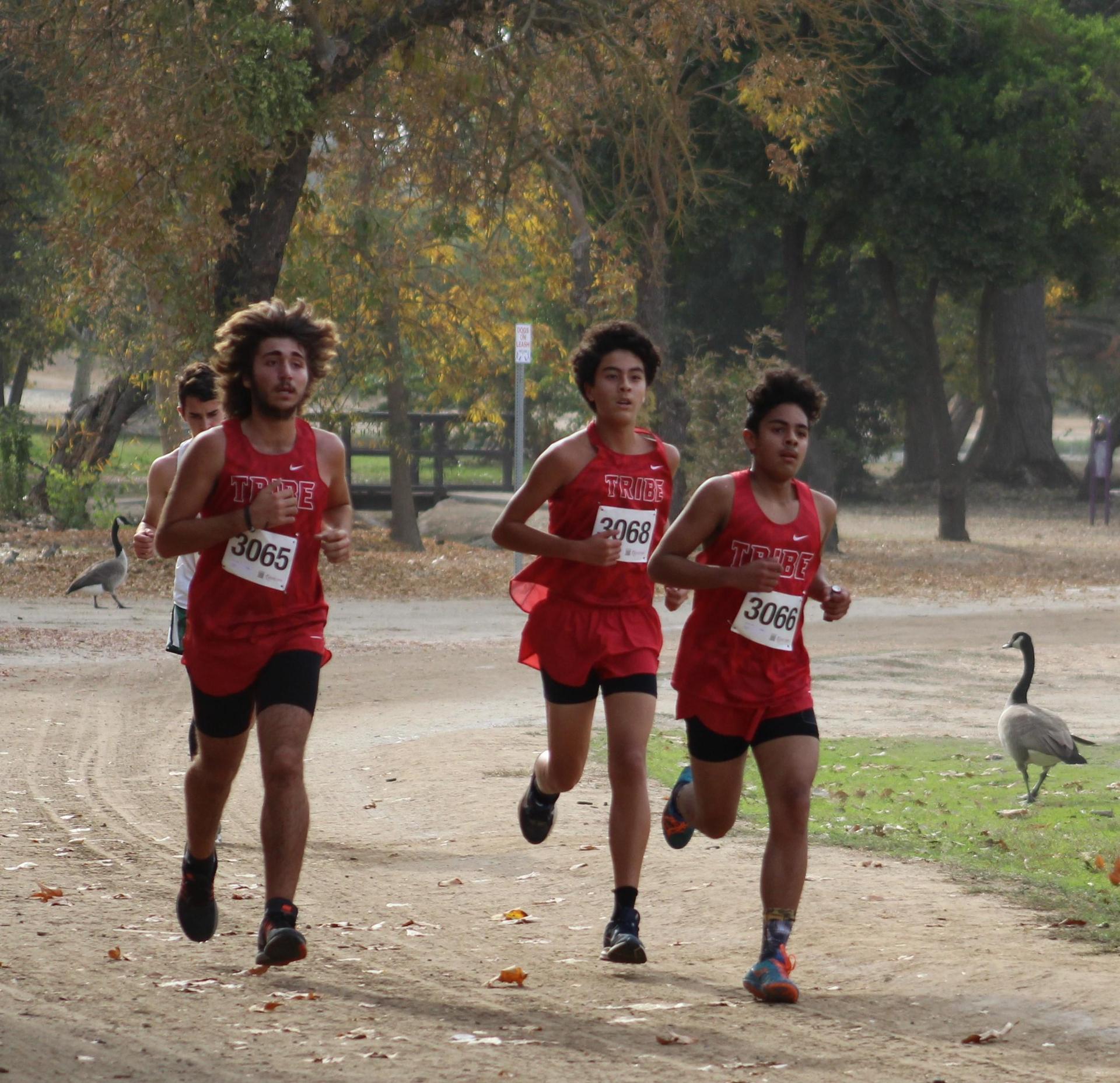 Antonio Brasil, Nicholas Lopez, Isaac Gonzales running