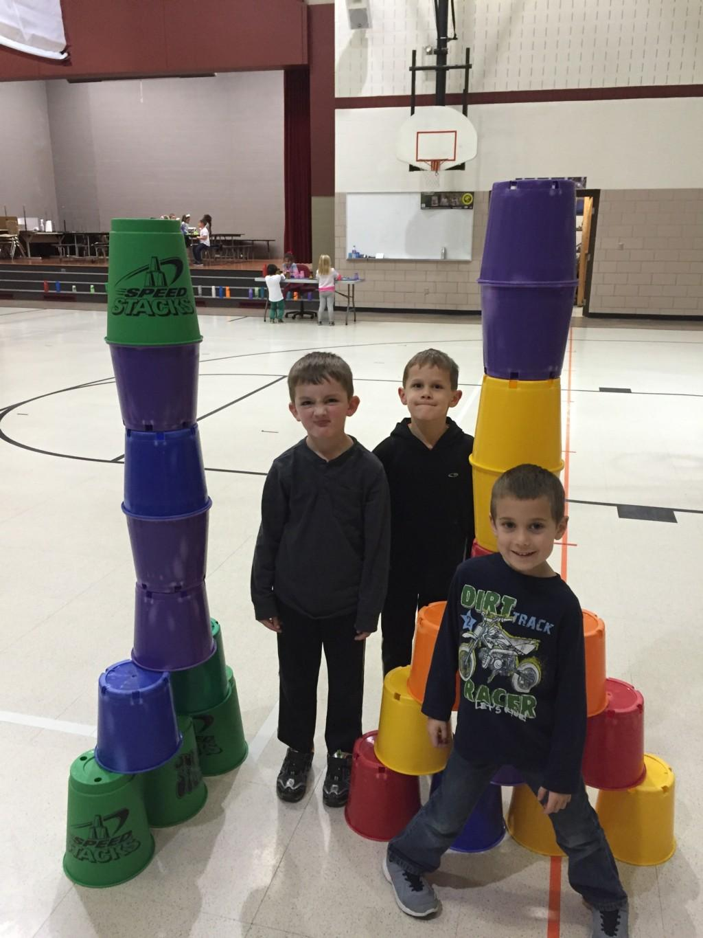 students show off two stacks of pails
