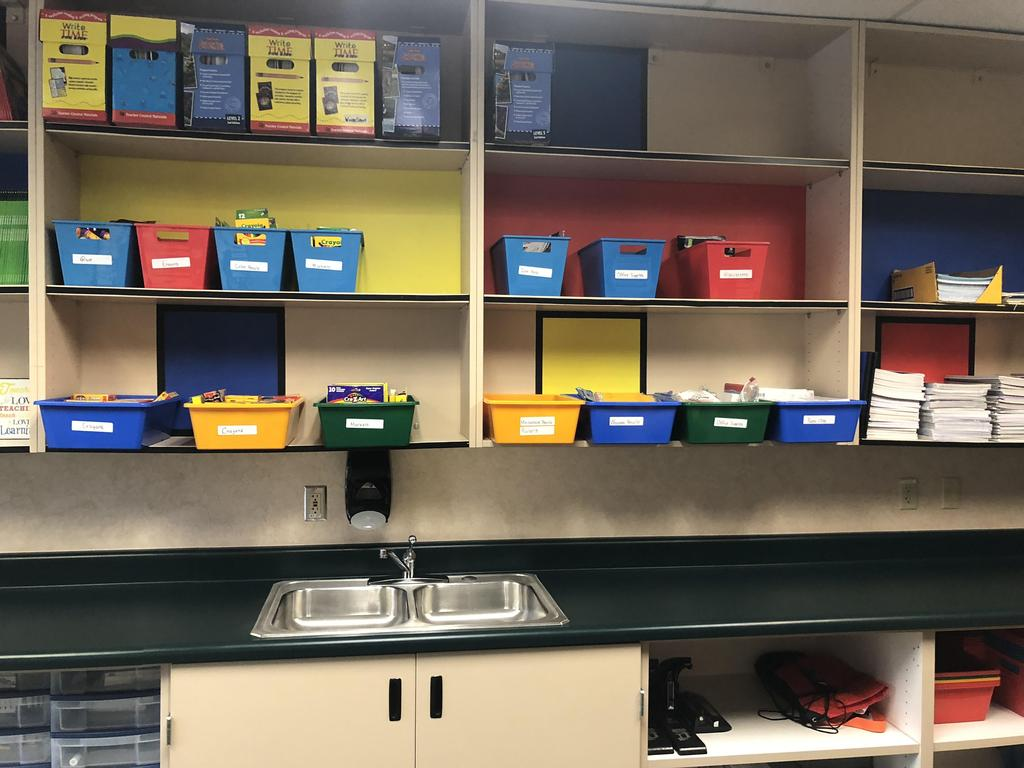 work room with organized storage bins