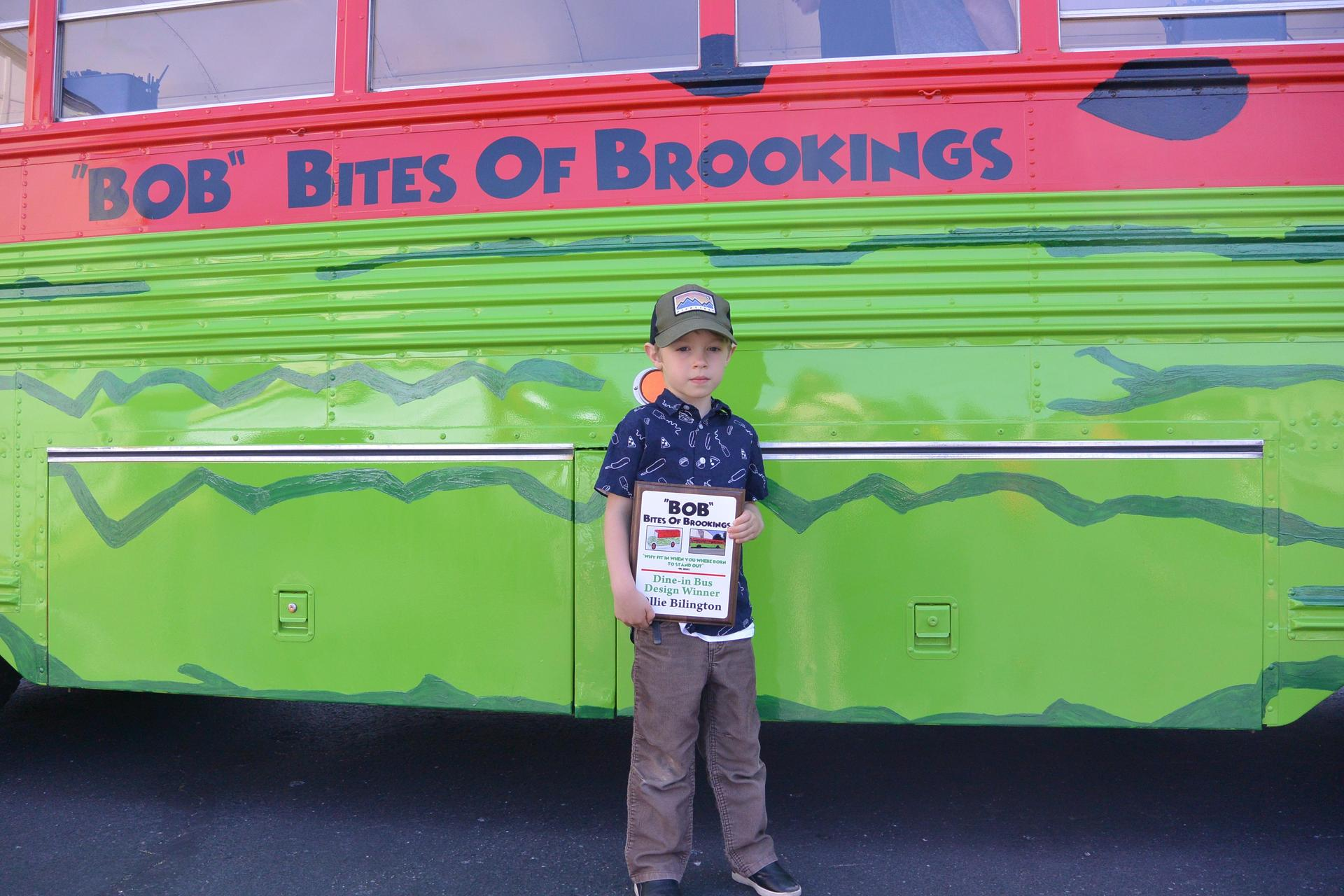 Oli in front of bus