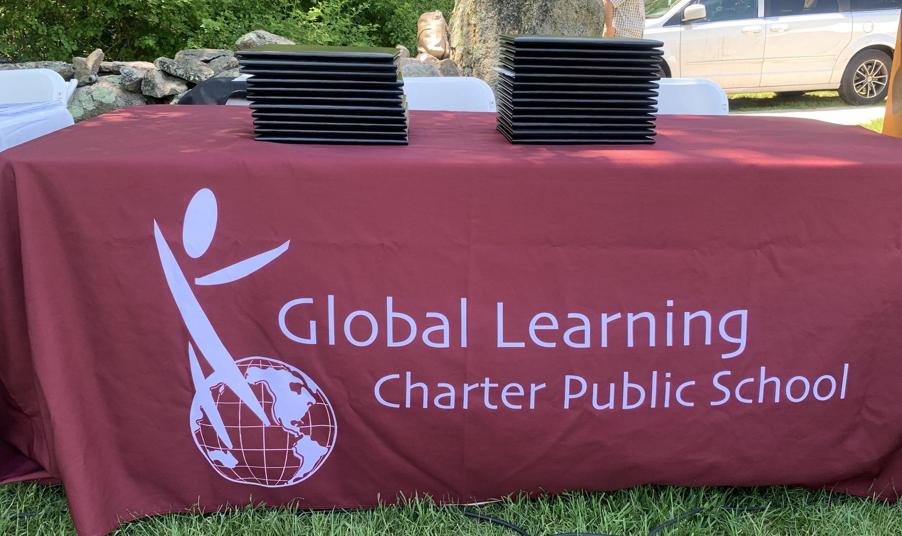 GLCPS tablecloth with logo and diplomas